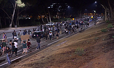 Hundreds of protesters march from UC San Diego ...