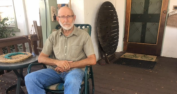 Jim Baross sits on his porch in Normal Heights. He retire...