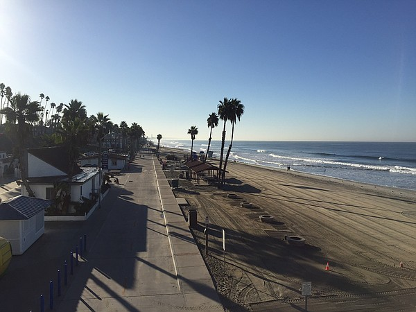 A stretch of beach near the Oceanside Pier is seen in thi...