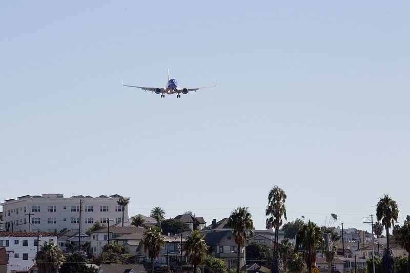 An airplane flying over Bankers Hill before landing at San Diego Internationa...