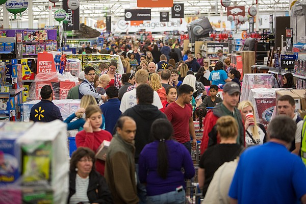 Customers at Walmart's Black Friday shopping event in Rogers, Ark, Nov. 26, 2...