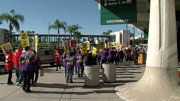 Fight for 15 protesters march at San Diego International ...