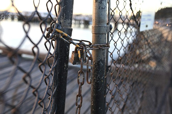 Today, the Grape Street piers lie behind padlocked gates.