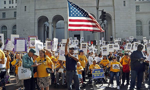In this Oct. 28, 2014, file photo, demonstrators take par...