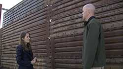 I stand at the border fence in San Diego with Shawn Moran, Nov. 17, 2016.