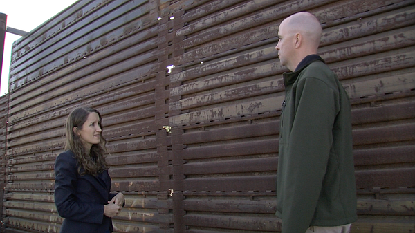 I stand at the border fence in San Diego with Shawn Moran...