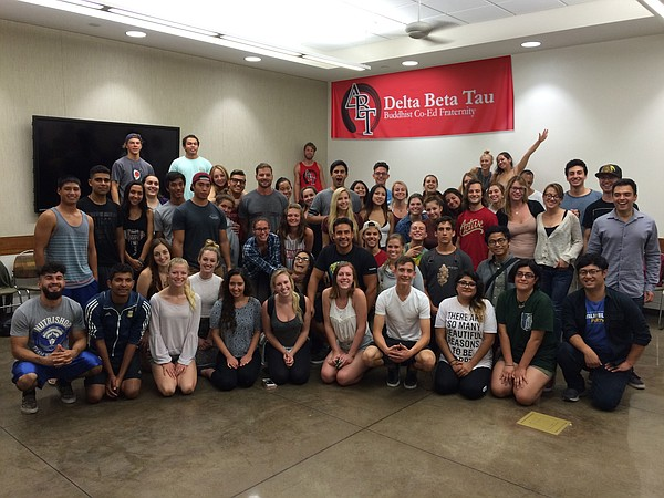 Delta Beta Tau students at a Wednesday night meditation s...