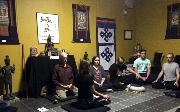 Students learn mediation form at the Buddha For You store...