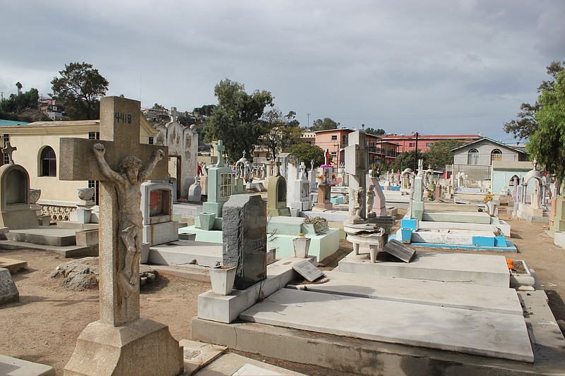 Grave markers rise in a Tijuana cemetery, Nov. 2, 2014.