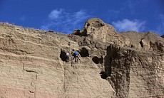 Climbers Pete Athans and Jake Norton excavating... (93273)