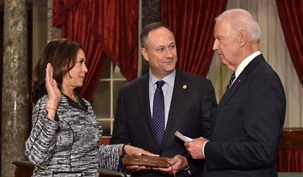 Vice President Joe Biden swears in Sen. Kamala Harris, D-California, while he...