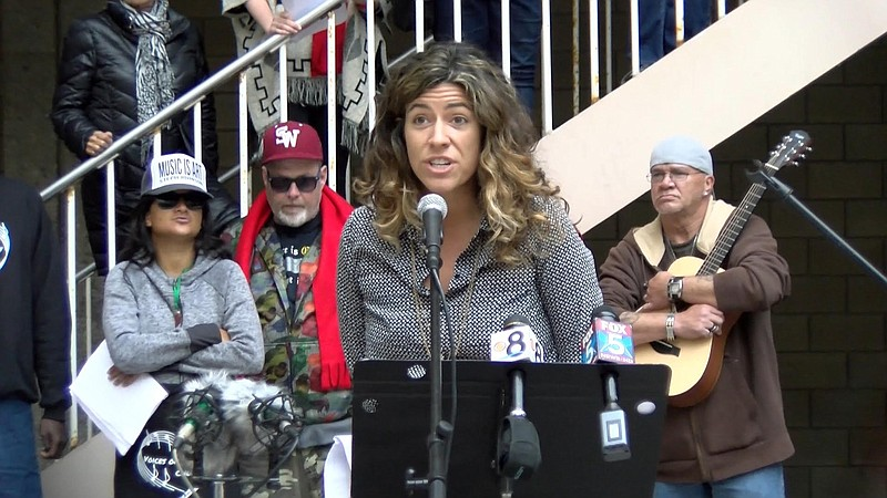 Steph Johnson speaks at a rally where she and other advocates for the homeles...