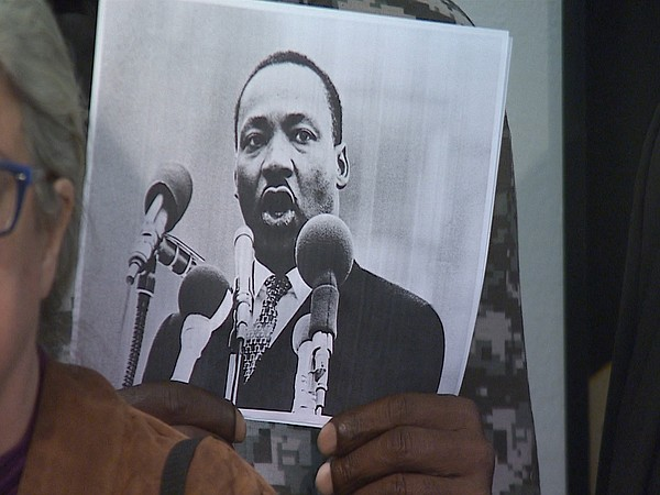 A person holds an image of Martin Luther King Jr. on Jan....