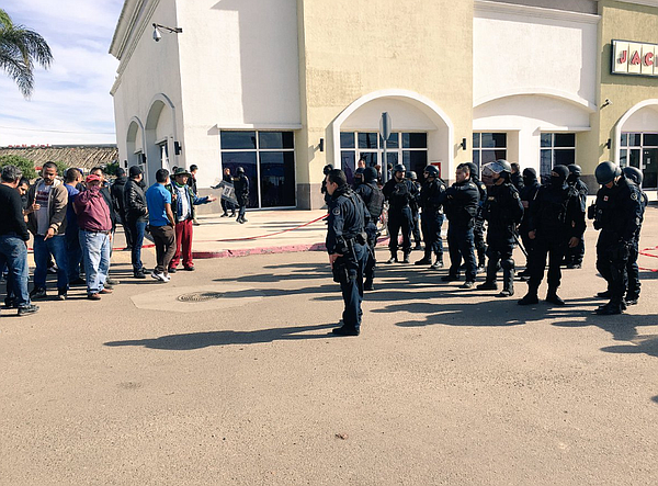 Gas price protestors face off with police at Rosarito shopping center