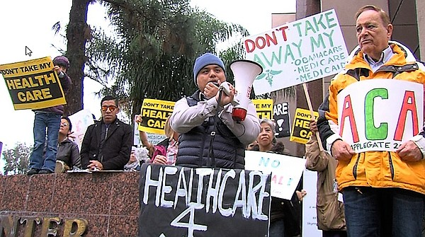 People protesting Cong. Darrell Issa's position on Obamac...
