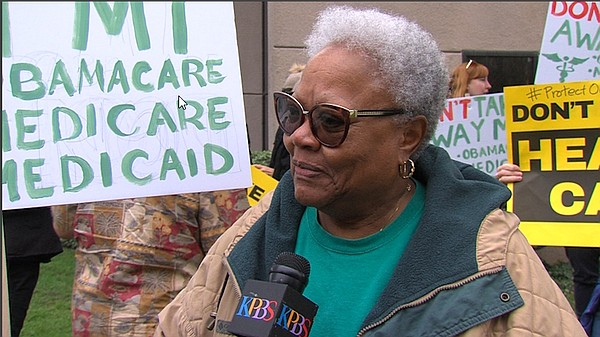 Vista resident Marjorie Bramwell protesting at Cong. Darr...