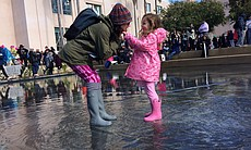 A woman and a young girl play in water at the W...