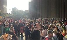 Demonstrators gather at the Civic Center Plaza ...