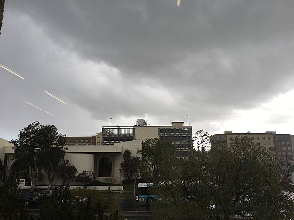 A winter storm brings rain and hail to San Diego State Un...