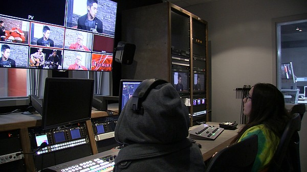 Students at Hoover High School monitor an on-set interview from the control r...