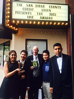 Hoover High School Teacher John Michener (center) and students pose with an a...