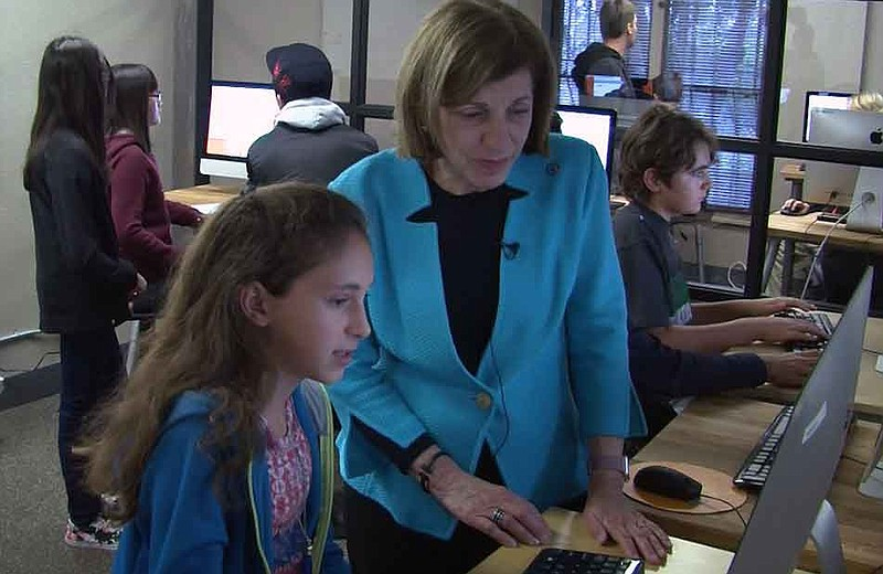 Sixth grader Dasha Zerboni shows City Councilwoman Barbara Bry a coding progr...