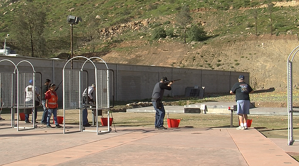 People line up to shoot at clay targets at an outdoor gun range at P2K Sports...