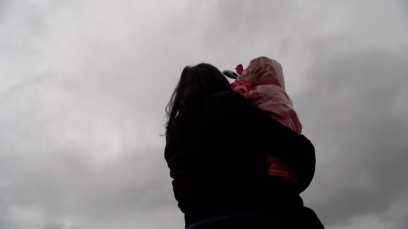 A San Diego immigrant, Marina, shows a little girl the sky, Jan. 22, 2016.