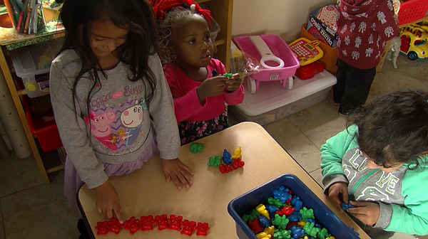 A 4-year-old named Evelyn counts plastic bears, Jan. 19, ...