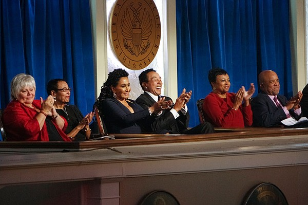 Honoree Smokey Robinson applauds during a performance at ...
