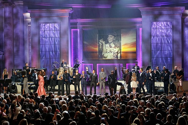 Smokey Robinson center stage during the all-cast finale a...