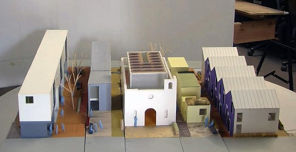 A model of the Casa Familiar project planned at the site ...