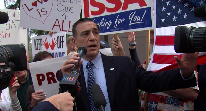 Rep. Darrell Issa (R-Vista) talks to a crowd of 200 supporters and critics ou...
