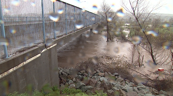 Tijuana River is swollen with rainwater and tainted with sewage on Feb. 27, 2017