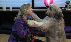 Julie Potiker and her briard, Madeline, during ...