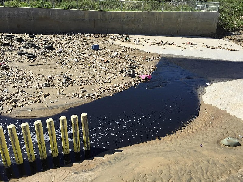 Polluted water flowing out of Goat Canyon into the Tijuana River Valley near ...