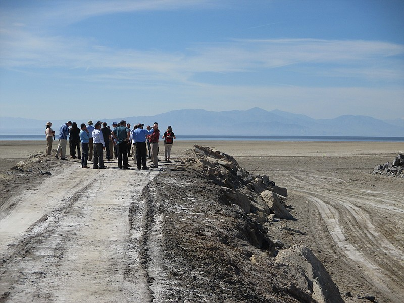 State lawmakers and state agency representatives look at an area that once was covered by water from the Salton Sea, March 16, 2017. The sea in the distance.