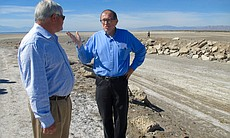 Bruce Wilcox, assistant secretary of Salton Sea policy for the California Natural Resources Agency, speaks with an attendee of a tour of the Salton Sea, March 16, 2017.