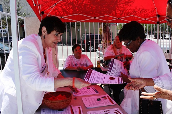 Elizabeth Bustos hands out materials to promote disease p...