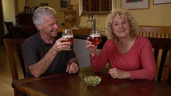 Host Nan Sterman (right) and Curt taste beer.