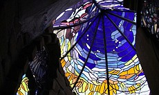 Stained glass designed by artist Jim Hubbell adorns one of the buildings on h...
