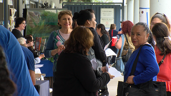 Job seekers and educators attend a job fair at the San Ys...