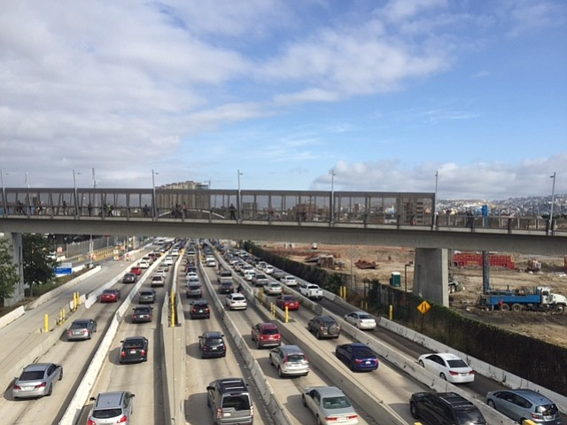 Cars wait in traffic to cross the border to Tijuana, May 9, 2017.