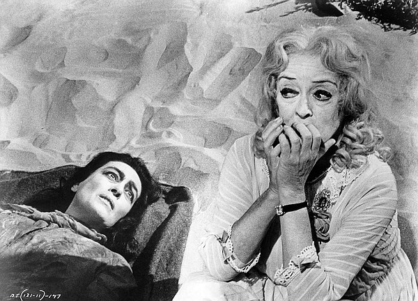 Joan Crawford and Bette Davis deliver gothic horror as famous sisters in a tw...
