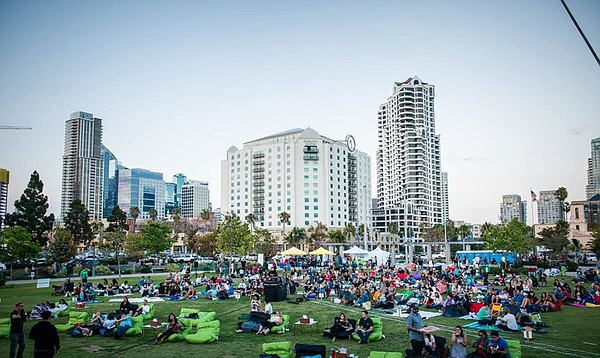 A 2016 photo of Street Food Cinema San Diego outdoor film...