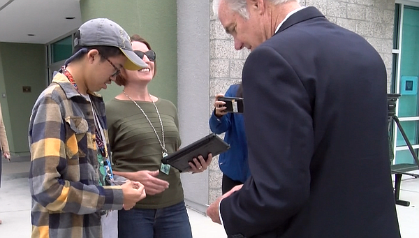 A Del Norte High School student introduces himself to State Superintendent of...