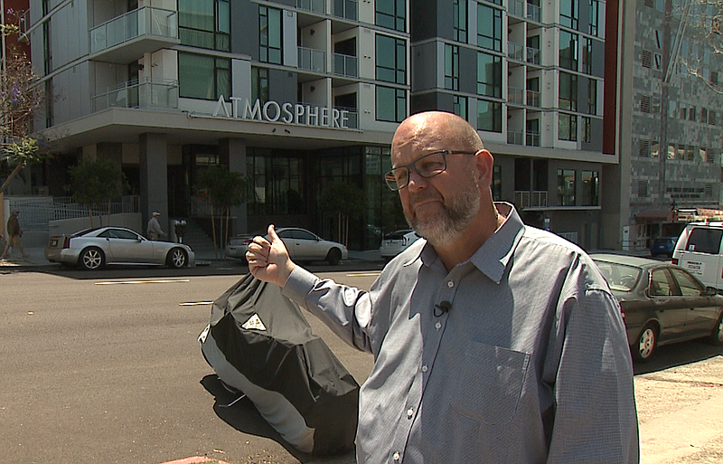Homeless advocate Michael McConnell points to Atmosphere, a 205-unit affordab...