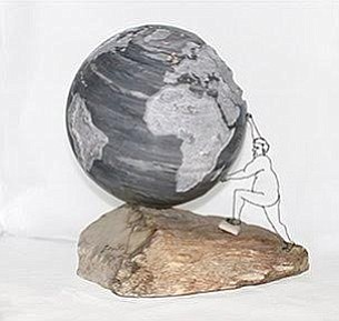 A photo of a marble sculpture by Lileane Peebles titled Tipping Point, 2016.