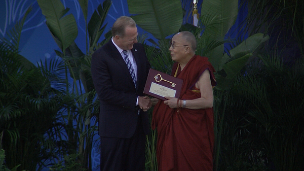 San Diego Mayor Kevin Faulconer presents the Dalai Lama with a key to the cit...