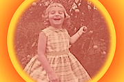 Portrait of Donna Frye as a child holding a shrub branch